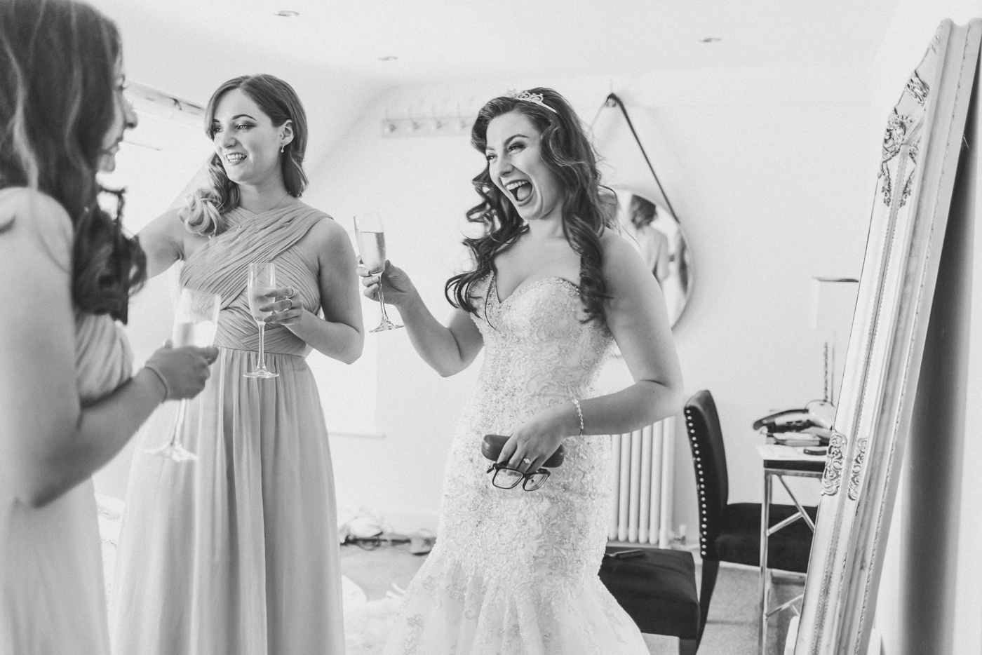 bride shares Champagne with her bridesmaids